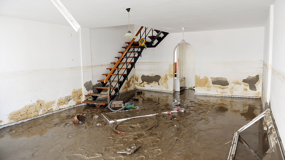 Flooded basement with insurance claim
