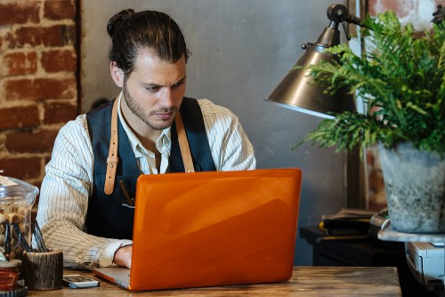 Man working on Mortgage Calculator with Insurance and Taxes