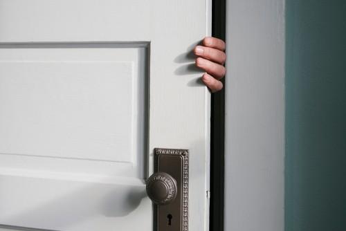 Hand opening door before security assessment