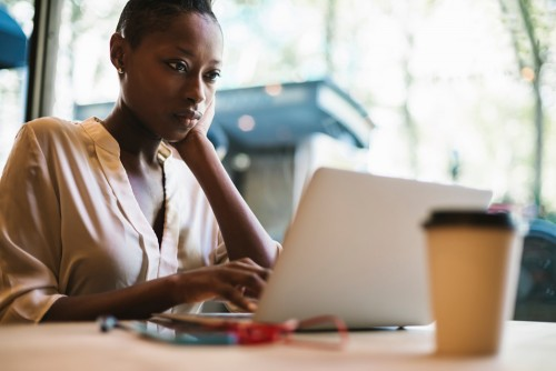 woman on computer researching PMI Insurance