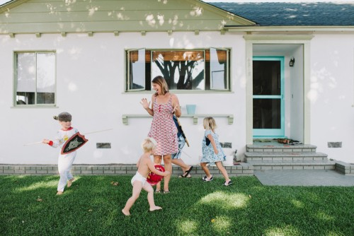 kids playing in yard during the best time to sell a house