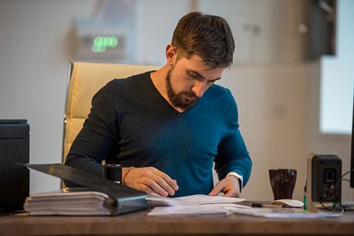 man looking at taxes - Is PMI tax deductible