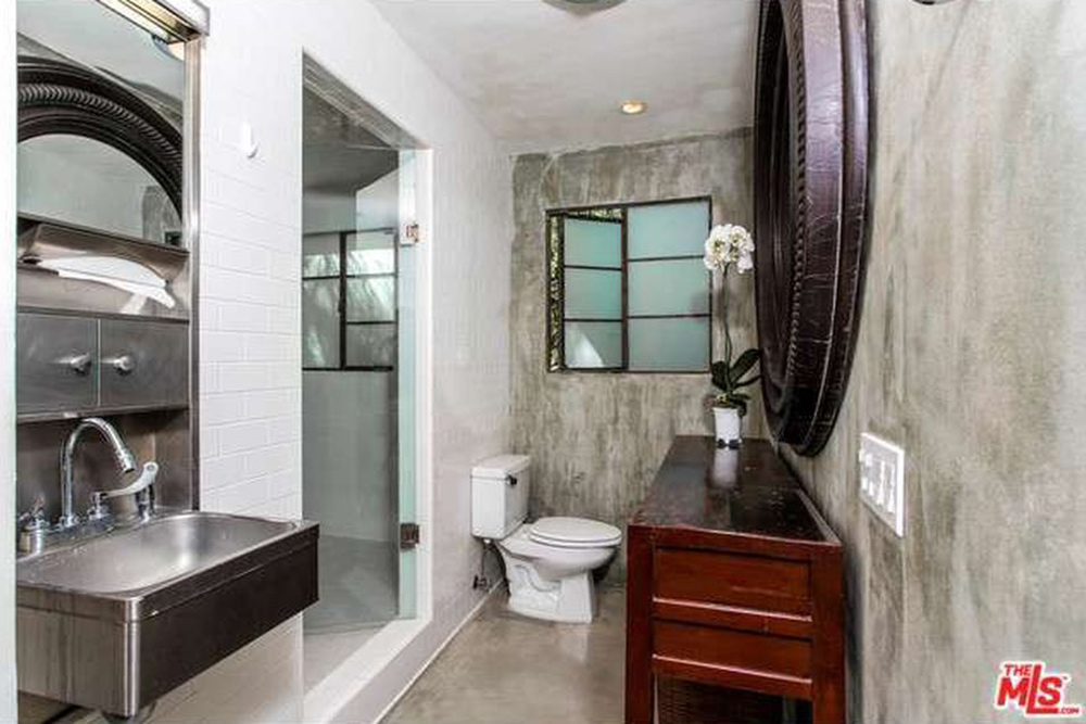 The Chainsmokers Alex Pall Buys In LA insudtrial bathroom