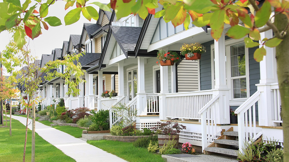 pretty houses in a row with property value estimate
