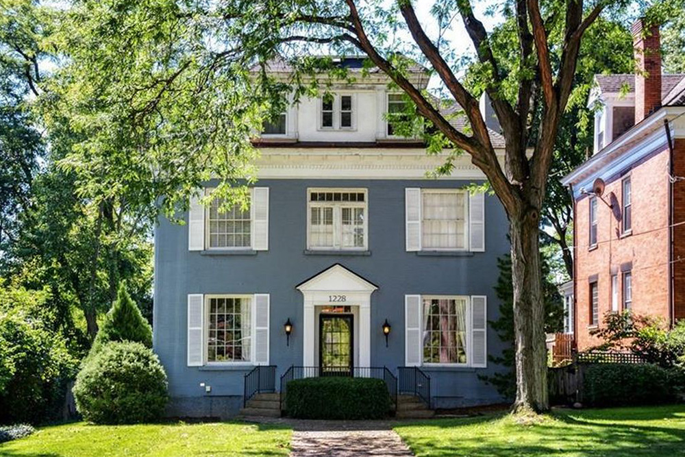 architecture styles blue house white shutters