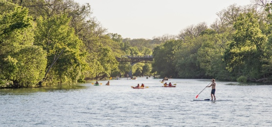Locals kayaking and paddle boarding in Old West Austin