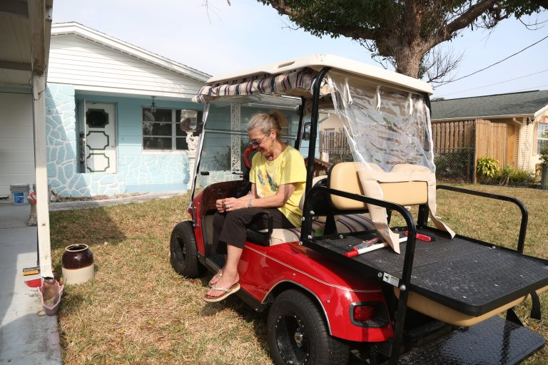 A woman who bought her evicted neighbor her house back.