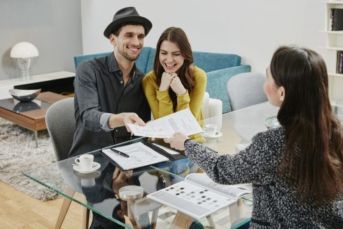 Couple signing a zero-down mortgage