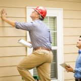 Inspector identifying problems a home seller should fix