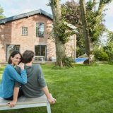 Homeowner couple considering the tax implications of a second home